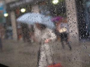 Umbrellas in the rain by Ed Yourdon via Flickr
