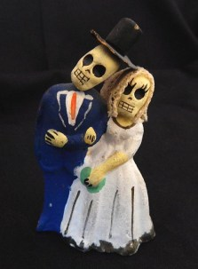 Male/Female couple with skull faces