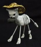 Skeleton cat eating rat