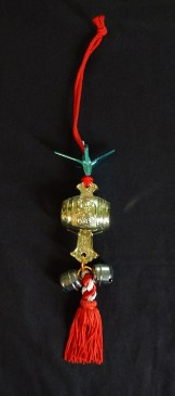 "Protection-Japan-Buddhist? Shinto?-Red thread/Plastic sake barrel/Origami crane/Bells-7 1/2"" long"