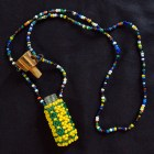 Beaded necklace with beaded container and stopper
