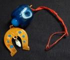 Amulet with horseshoe and blue beads