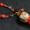 "Protection and good luck-Mexico/USA-Mexican/Indigenous-Velvet bean or cowhage (Mucuna pruirens), amber bead, image of virgin, red beads, red pom poms and black horn-4"" long"