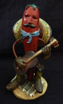 Mexican chile-man with sombrero playing guitar