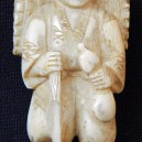 Figure of male peasant with backpack