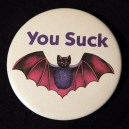 """Pin, """"You Suck"""" with drawing of a bat"""