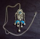Amulet necklace with Hamsa, blue beads and evil eye symbol