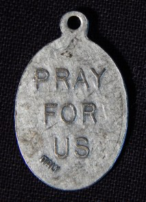 Reverse side of pendant of St. Isidore