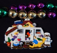 Close-up of house trailer pendant attached to Mardi Gras beads
