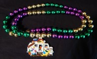 Mardi Gras beads with house trailer pendant