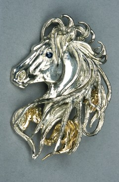 McCuin is a native Nevadan and premiere Western engraver/jeweler.