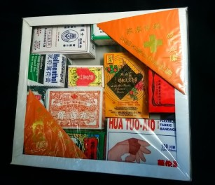 """Purchased new in 2018 at a religious goods stall in St. Paul, Minnesota's Hmongtown Marketplace. Most likely manufactured in China. Paper with transparent plastic wrapping. 10""""x10""""x1.5""""."""