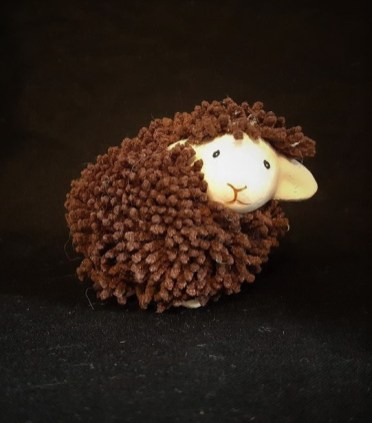 "Purchased in Tórshavn Faroe Islands in 2016. Materials: ceramic, synthetic yarn, Dimensions: 3"" x 2"" x 1.5"" This is a ceramic sheep covered in soft tufts. I found it in the bookshop in Tórshavn Faroes and chose it from among many sheep options because of its design. Most sheep related souvenirs take the form of magnets, postcards, tea towels or soft toys, I liked that this sheep was none of those. Faroese sheep are a distinct breed and I liked having a souvenir that while not depicting that breed, was itself distinct in form from the other sheep in my collection."
