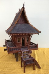 """25"""" x 23"""" x 15"""" Made from Mahogany, Koa, and Walnut. The flowers on the lower left post indicate that this is the SaoEk post, or main post of the house. In real structures it also defines which room is the main bedroom. In SE Asia, the direction of the stairs can indicate the social status. A ladder running up the side is for the average dwelling. A broken or L run indicates a Governors house. A straight run in means it's a Temple, as in the large black spirit house shown later. I haven't followed to this strictly in building, choosing to use whatever I felt fit the work piece."""