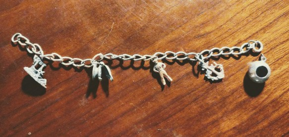 """Silver chain 7"""" long with 5 charms each about 1/2"""" to 3/4"""" tall; the waffle iron is hinged."""