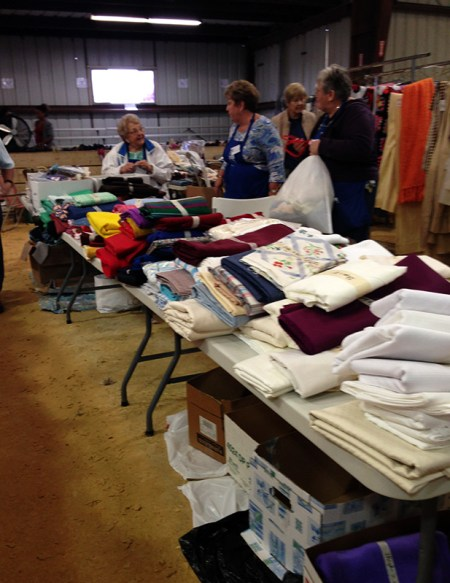 rummage sale in the horse barn - fabric tables