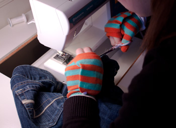 sewing in striped gloves
