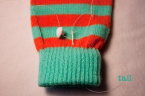 stitching buttons to knit: step 3