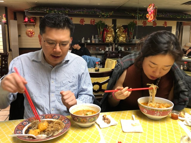 Taehoon and Lea Kim enjoying bowls of curry laksa, Malaysian breakfast noodle soup, at Curry Leaves.