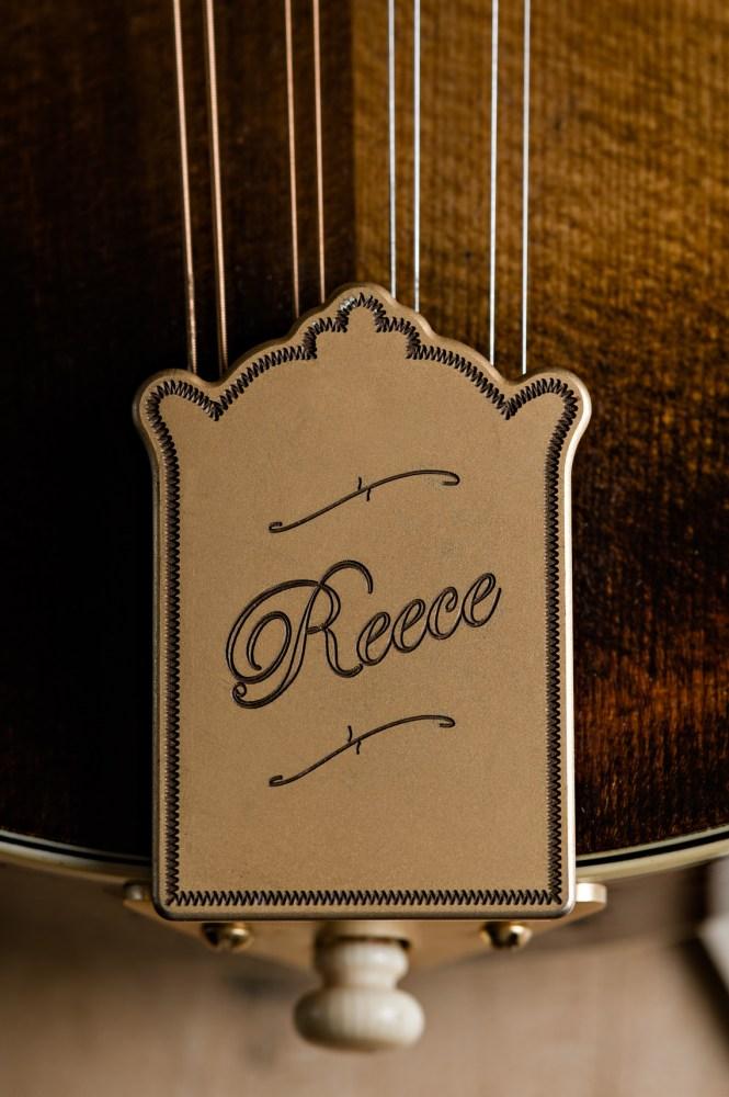 Reece spelled in cursive on string instrument