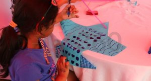 Girl making kite - Modern kite making workshop