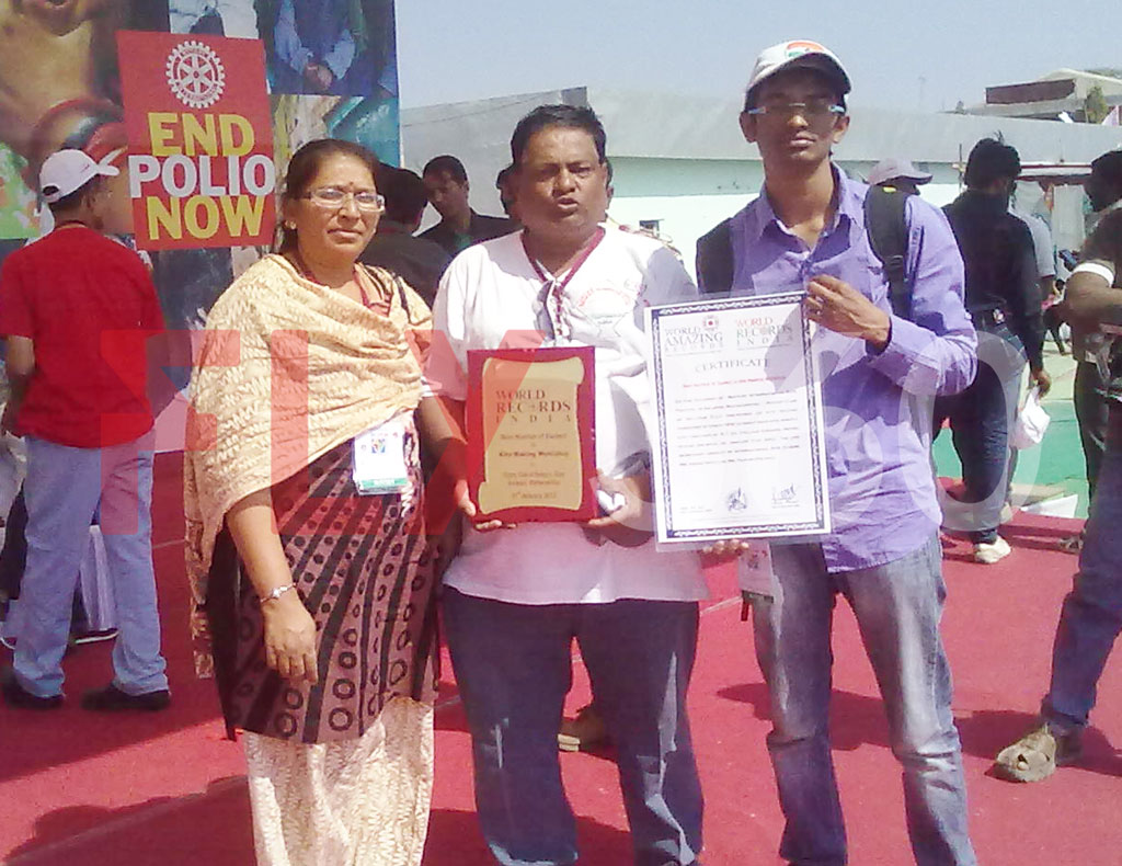FLY360 team with shield and certificate for successfully conducting modern kite making workshop - kite festival