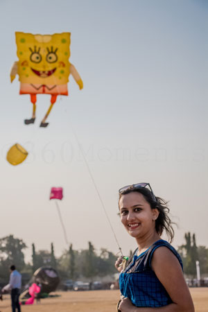 women flying kite