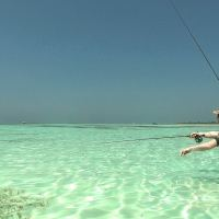 A Stranger and a Few Trevally On The Maldives Flats