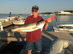 Rickey's first Boston striped bass on surface plug