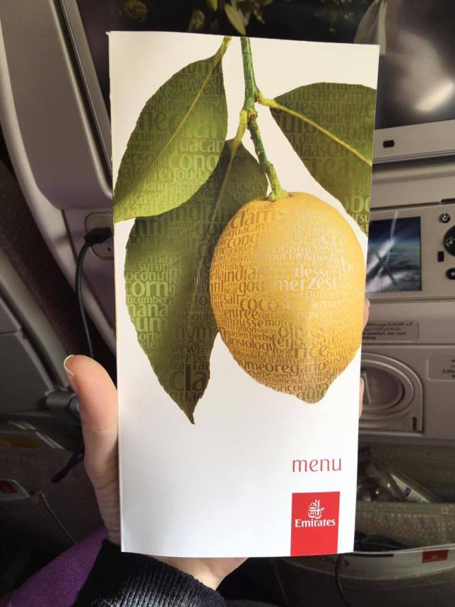 white menu card with a picture of a lemon on the branch and a red Emirates logo in the bottom right