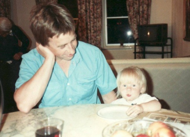 Rosie as a toddler and her dad sitting at a table