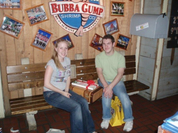 Rosie and Karl on a bench in Bubba Gump's SHrimp Shack Times Square
