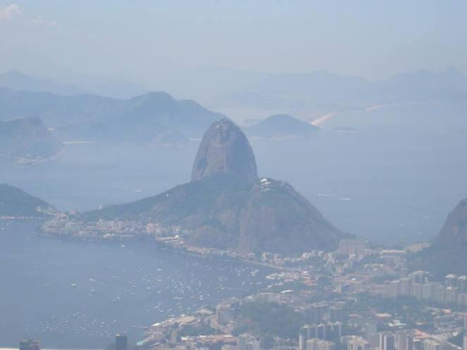 A hazy photo of Sugar Loaf Mountain from Cristo Redentor, Rio de Janeiro
