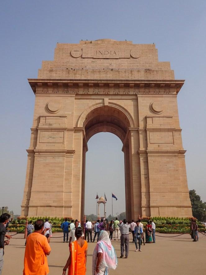 India Gate war memorial with tourists walking around, Delhi, India