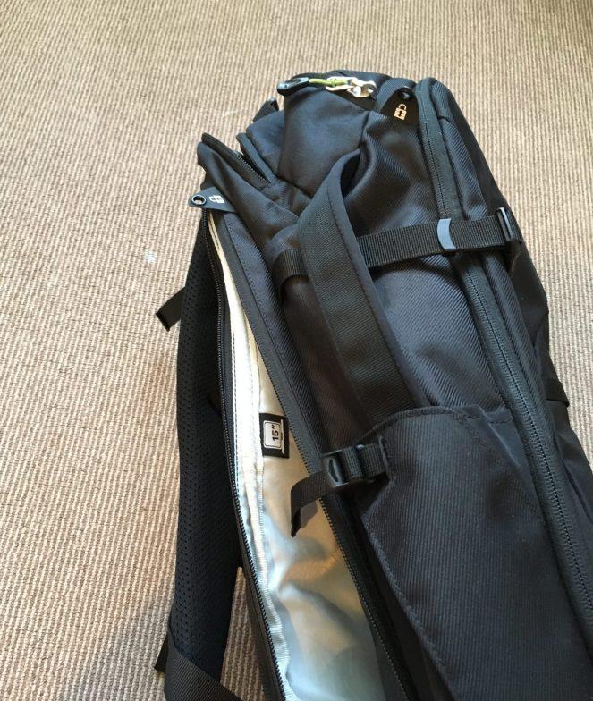 The back laptop pocket on a black Kathmandu Litehaul 38L Backpack
