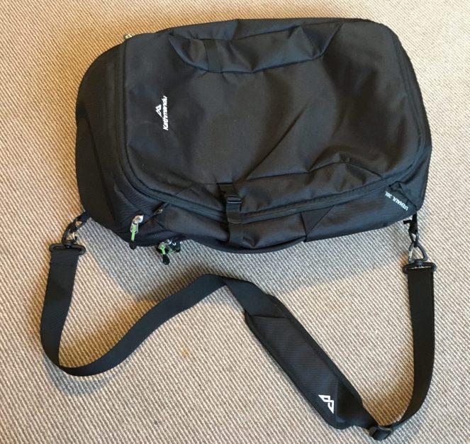 black Kathmandu Litehaul 38L backpack with detachable shoulder strap