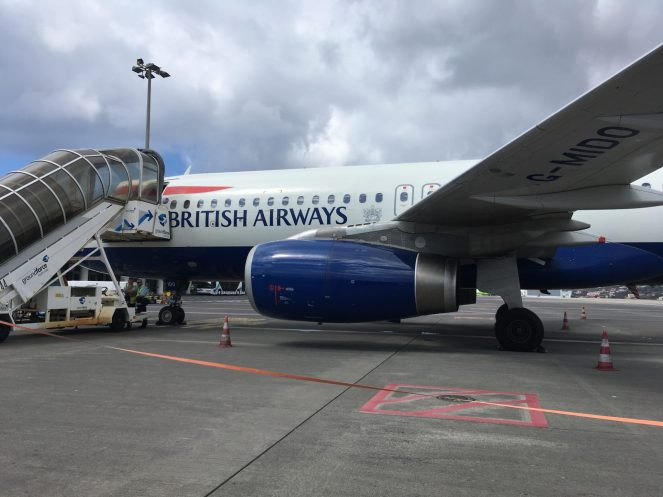 Side view of a British Airways Airbus A320 parked on a stand