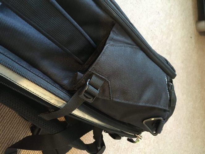 Side bottle pocket on a black Kathmandu Litehaul 38L Backpack