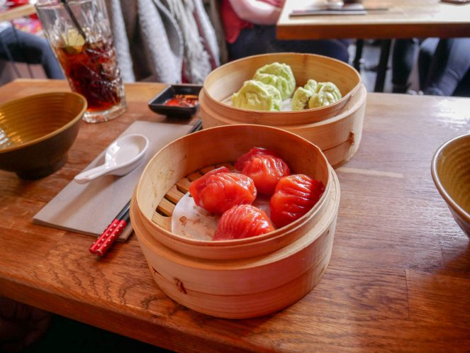 "4 ""ruby prawn dumplings"" and 3 pork buns in wooden baskets at BoaziInn restaurant, Soho, London"