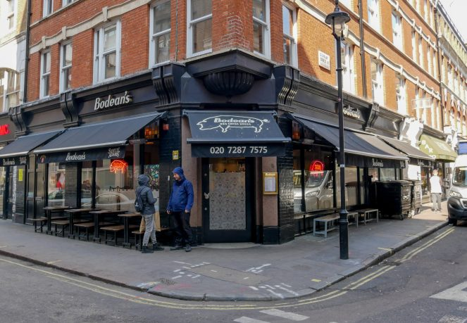 The black walls and awnings of Bodean's BBQ Smoke House restaurant, Poland Street, Soho, London