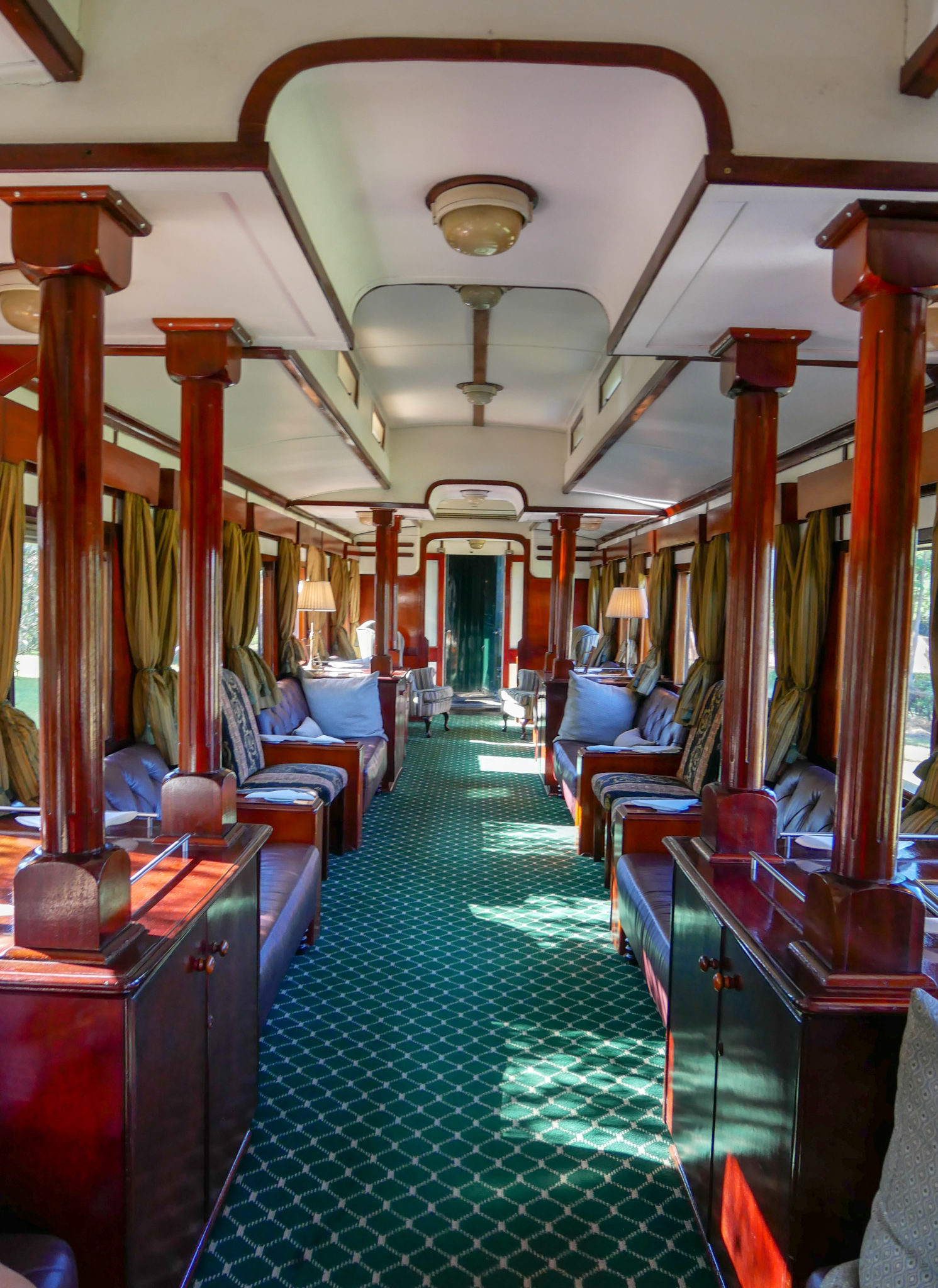 Inside the green carpeted Lounge Car of the Royal Livingstone Express train