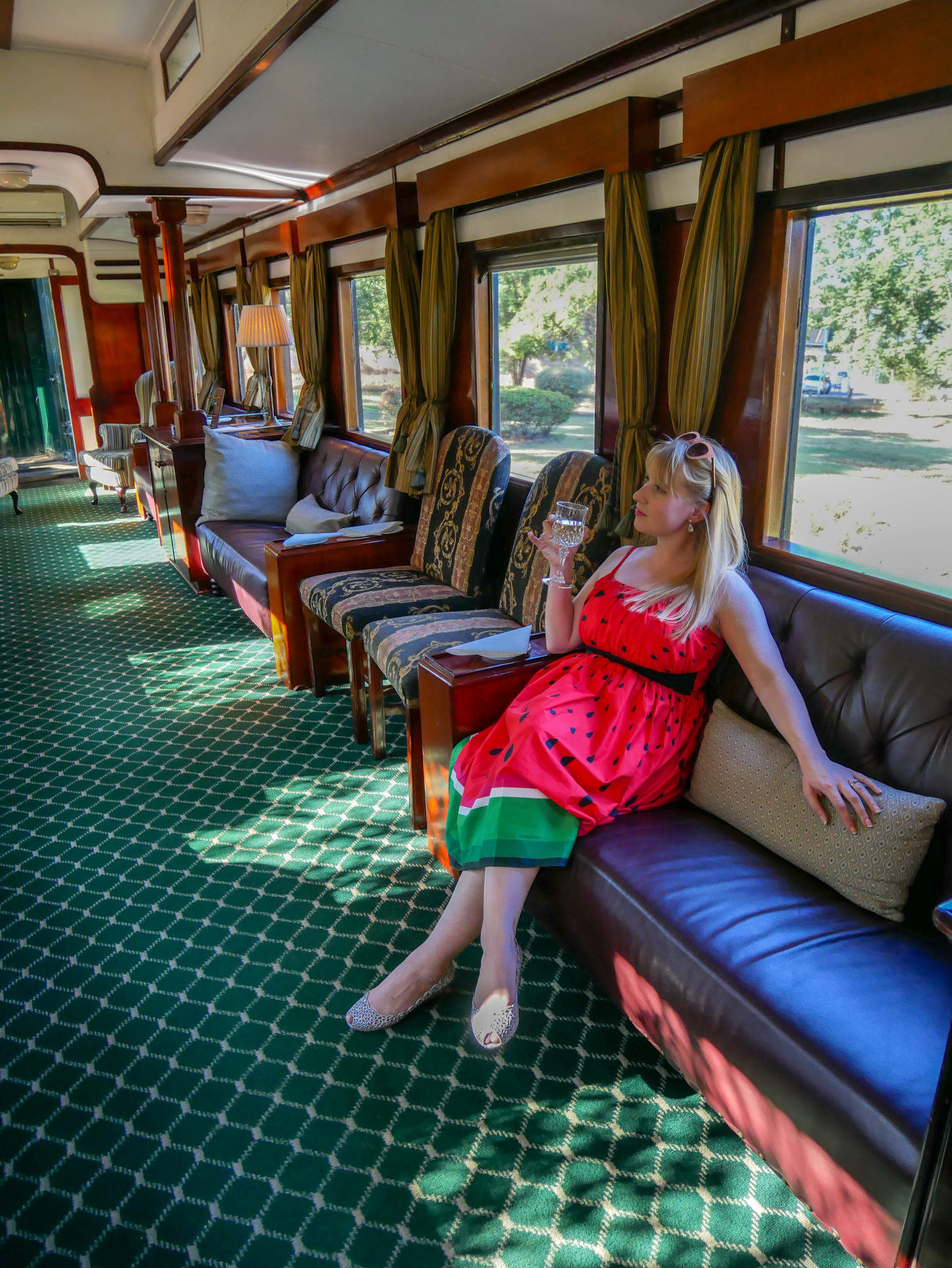 Rosie sits on a leather sofa in the Lounge car of the Royal Livingstone Express train