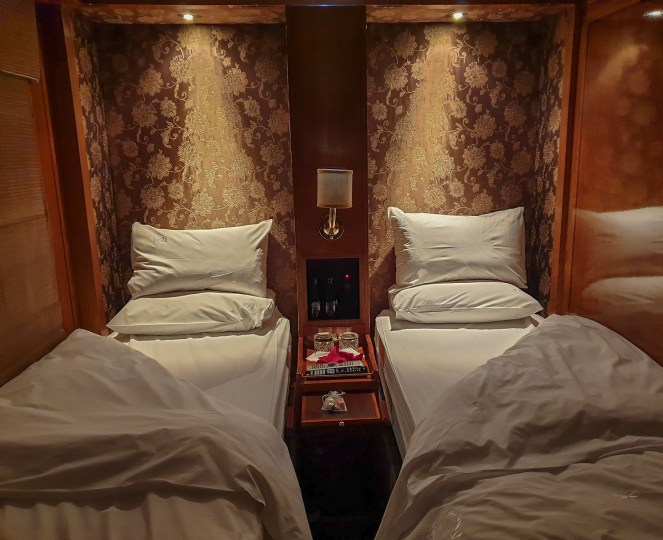 The single beds turned down at night in the De Luxe Suite on The Blue Train