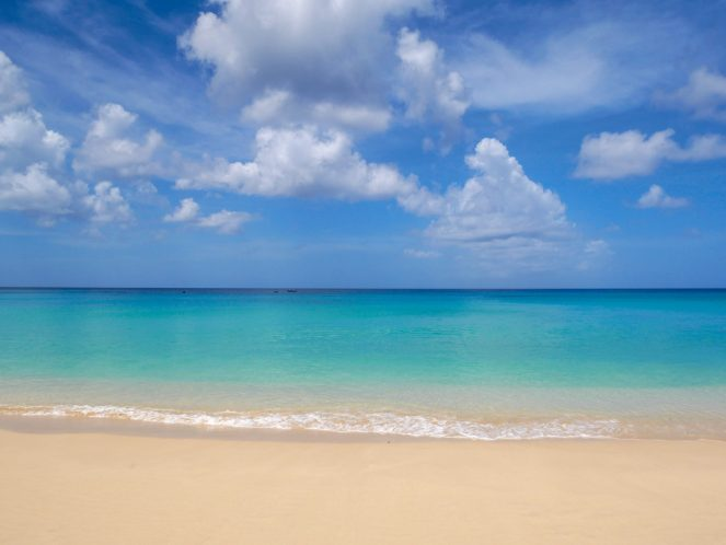 A ridiculously turquoise sea, captured at Sandy Lane Beach.