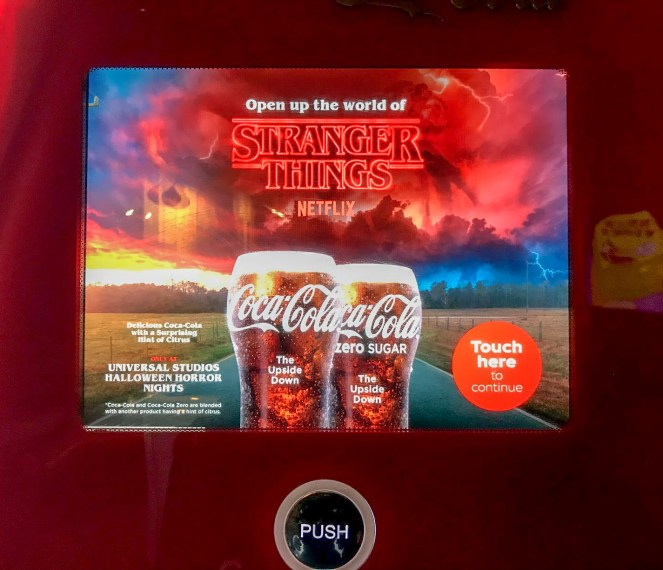 The screen on the Coco-Cola freestyle machine advertises special Coke for Stranger Things