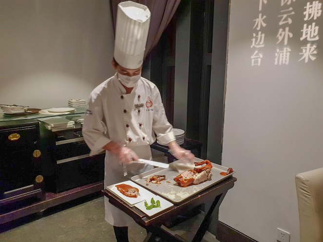 a chef carves Peking Duck in Da Dong Restaurant, Beijing, China