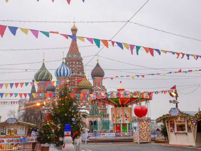 a Christmas fair on Red Square in front of St Basil's Cathedral, Moscow, Russia