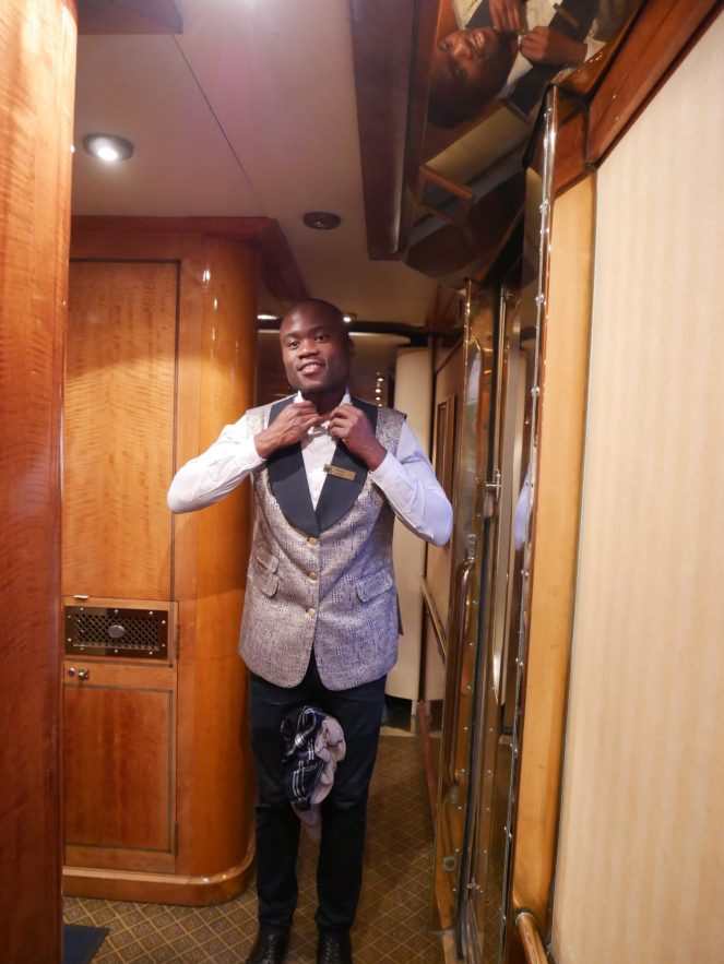 A butler in the corridor on The Blue Train
