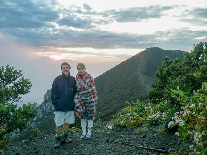 Karl and Rosie (wrapped in a blanket) standing near the summit of Mount Merbabu, Indonesia
