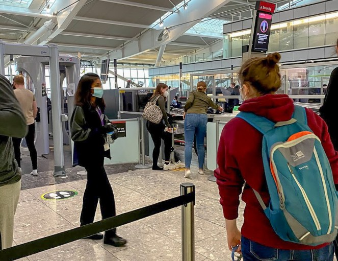 passengers going through airport security at London Heathrow Terminal 5